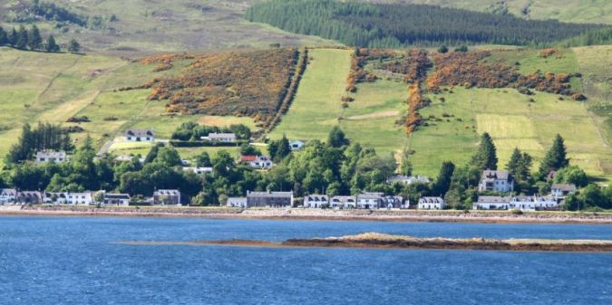 A view of the village of Lochcarron, taken from the opposite shore of Loch Carron. Photo credit: Anthea Zell.